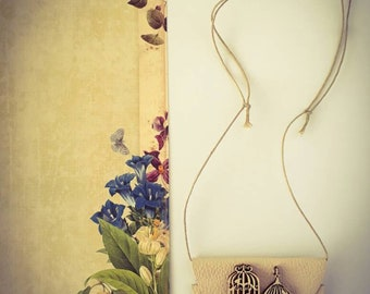 A Leather Pendant with Wood Birdcage details.
