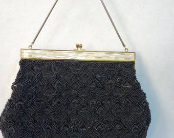 Vintage beautiful evening bag embroidered with silver coloured scales, heart embossed pattern. Gold chain, clasp faux Pearl.