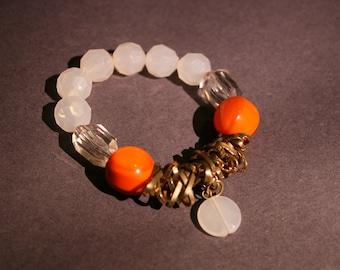 Unique orange and white beaded bracelet
