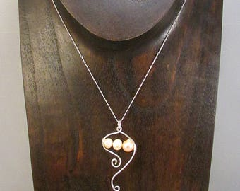 Pink pearl necklace with silver swirls