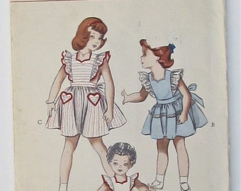 Pinafore With Ruffled Edge Back Button Closure Dirndlish Skirt Girl's Size 2 Used Vintage Sewing Pattern Butterick 5749