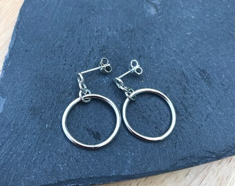 Circle drop earrings.