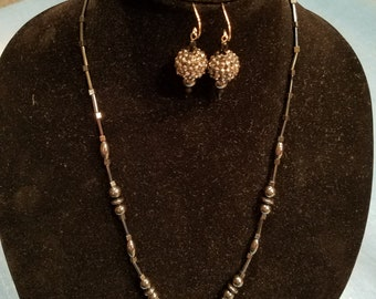 Necklace and earrings featuring hematite and sparkles