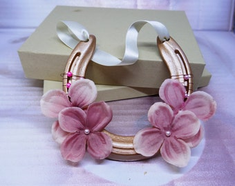 Genuine used copper and pink horseshoe