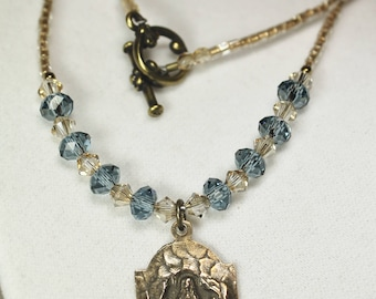Woman's Catholic Necklace; Mary in the Grotto & Blue Swarovski Crystal Necklace