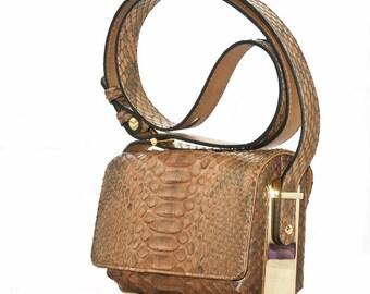Python leather handbag with exclusive metallic gold frame