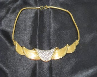 Faux Gold Choker with bling in middle front.    If you  like unusual, this is for you!