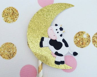 The cow that jumps over the moon cake topper