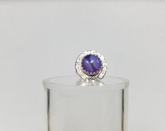 The ring is a size 6 it has a 12 mm purple onyx agate, set in a gallery bezel and bordered by  detailed pattern wire and blossoms.