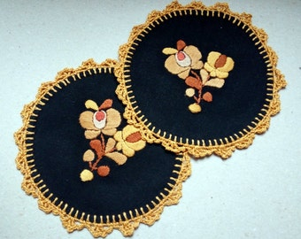 "Hand embroidered black 5.5"" doily with hand crocheted borders. Hungarian Matyo embroidery"