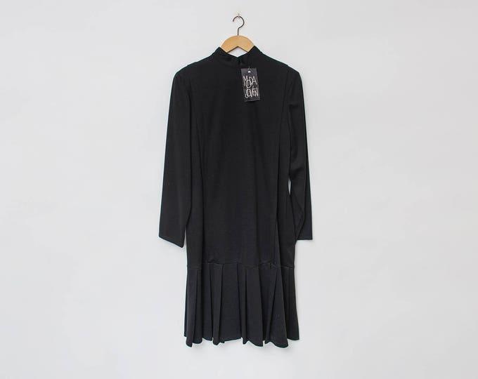 Vintage black dress with pleats dead stock