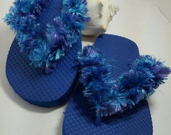 Crochet blue flip flops.