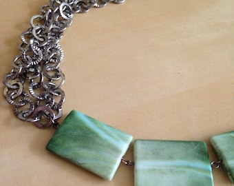 Multilayer textured chain with seven natural colored stone looking smooth beads