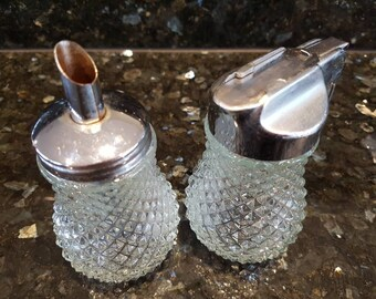 A set vintage glass  sugar and honey dispensers castor shaker
