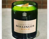 Upcycled Bollinger  Rose champagne bottle filled with pomegranate scented soy wax candle