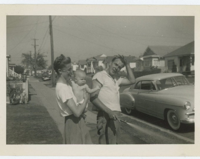 """Vintage Snapshot Photo: """"Maurie's got to 'slick up' for his picture...."""" October, 1952 (610510)"""