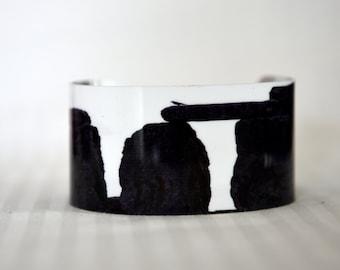 Aluminum cuff photography, Stonehenge and Raven, photo of a Stonehenge, Metallic finish on a beautiful sublimation cuff for wearable art
