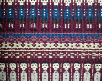 """Wall hanging hand woven """"Rosengång and Gubbatäcke"""" in wool with vine red,lilac,blue and brown fringe from Sweden 1960s."""
