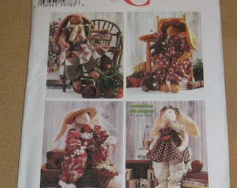 "Uncut Pattern - Simplicity 7459 - 24"" Stuffed Rabbits and Clothes - jumpsuit, vest, hat and bow, apron and quilt, collar, hat and  bow"