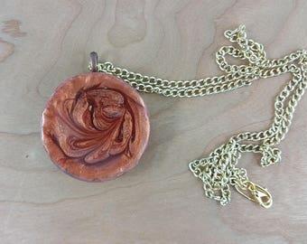 Necklace: bronze brown resin pendant on golden chain; Sandstorm on Mars; science fiction