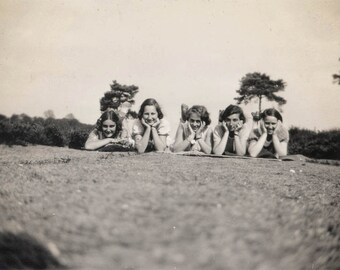 Vintage photo 1930 Teenage girls Line Up REst on Hands on Grass