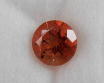 7mm fancy Red Oregon Sunstone with Schiller, 1.7ct