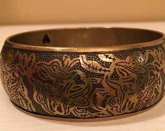 Vintage Brass Hollow Bangle Bracelet with Stamped out Hearts on the Inside