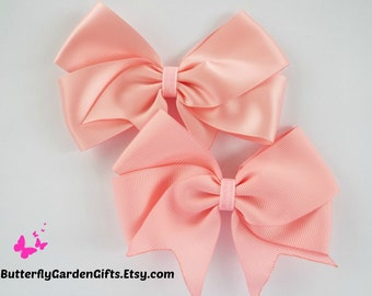 Pink satin or grosgrain tail down boutique hair bow