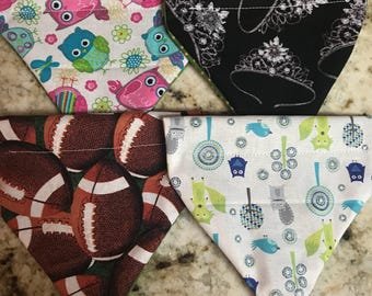 Small pet bandana.  Lots of fabrics to choose from.  Slides over pet collar.  Washable.  Adorable