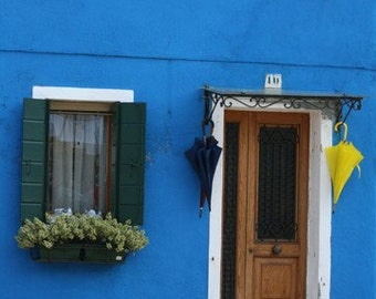 Blue House with Blue and Yellow Umbrellas, Burano, Italy, photograph