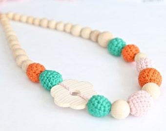 Floral nursing necklace. Green, pale pink, orange crochet teething necklace.
