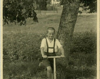 Boy on scooter antique toy photo