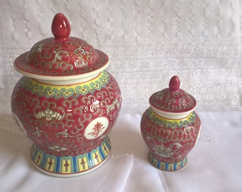 Very small pagoda shape hand painted Chinese porcelain ginger jar; red with yellow, jade green and blue highlights. Symbols and patterns.
