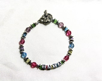 Multi-color swarovski and sterling silver name bracelet.