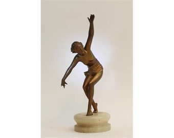 An Art Deco spelter figure in the form of a dancing maiden, 27cm