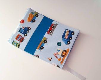 Baby boy health book personalized trains, trucks, tractors.