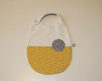 Bib printed triangles and stars, mustard yellow and gray