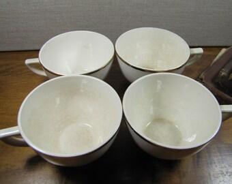 Set of Four (4) Creamy White Teacups - Gold Accent Rim - USA