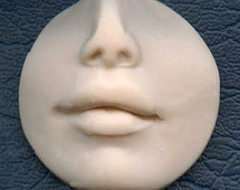 "Polymer Clay  1 1/4""   Top to bottom drilled  Fleshtone Nose and lips face Shard FLRDLT 2"