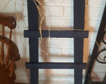 Primitive ladder raffia bow. Navy wood ladder. Painted ladder.