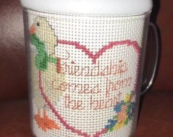 "Completed handmade cross stitch cup ""Friendship Comes From The Heart""."