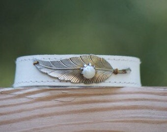 Vintage faux pearl pin on white leather cuff