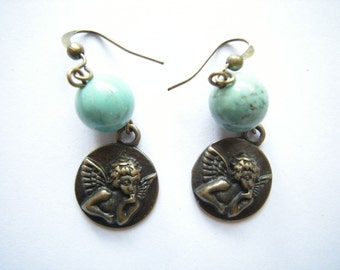 Antique Bronze Cupid Earrings with Turquoise Bead