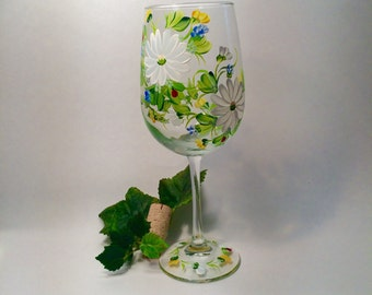 Free shippingDaisies hand and lady bugs painted on a wine glass personalizable