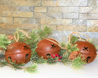 """Metal Bell with Loop 4 1/2 Inch Wide by 3 1/2"""" High, Flatted 115 MM Rusty Metal Primitive Bell with Star Cutouts, Wreaths, Garlands or Trees"""