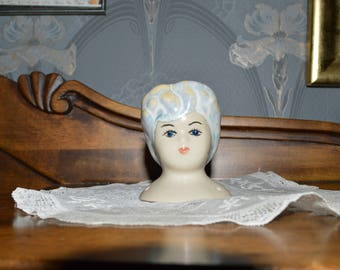Ceramic doll head.