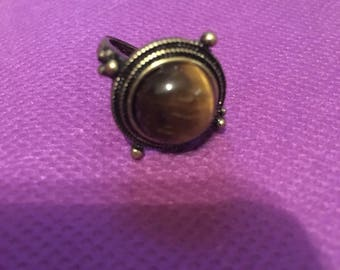 Gemstone ring in brass setting.