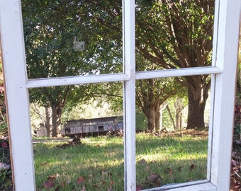 old farmhouse window mirror with original hardware and distressed white paint with 4 individule mirror panes