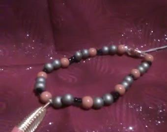 Orange Feather Bead Bracelet
