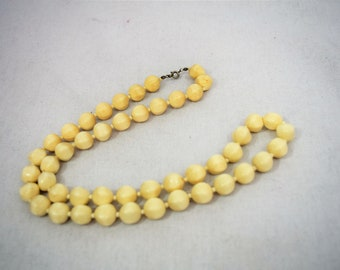 Vintage 1960s shaped antiqued white beads necklace